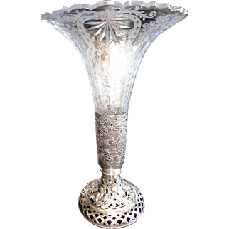 Monumental size silver repose and cut, etched crystal vase