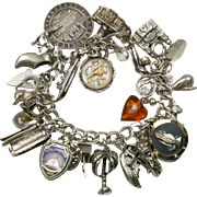 Vintage Sterling Silver Charm Bracelet with 29 Charms - 4 Mechanical