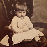 Cabinet Card: Cornelius With Big Eyes Wearing Knit Sweater And Striped Socks