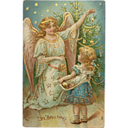 Gold Highlighted Angel Helps Child Decorate Tree