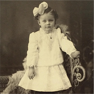 Cabinet Card-  Little Girl With Curls, Bow And Locket