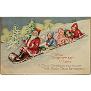 Santa And Little Friends On Toboggan