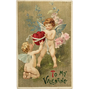 Two Cupids With Bundle Of Hearts