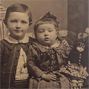 Sweet Brother With Sister Holding Doll