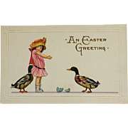 A Little Girl And Easter Ducks