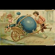 Embossed -Bright Blue Egg In Golden Cart