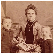 Cabinet Card- Mother And Sons With Photograph Album - Red Tag Sale Item