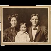 Studio Photograph- The Happy Family Of Three