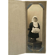 Matted Photograph- Happy Little Girl With White Muff And Hat