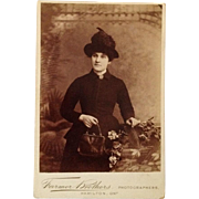 Cabinet Card: A Handsome Woman And Her Purse Shall Not Be Parted