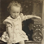 RPPC- Curly Haired Toddler In Summer Dress