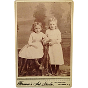 Cabinet Card: Two Little Girls, White Dresses, Hair Bows And High Buttoned Shoes