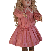 """Red and white checkered dress for a circa 25"""" tall doll."""