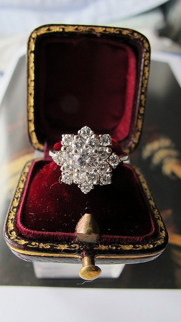 A diamond ring designed as a cluster, set in a 14 k white gold mount