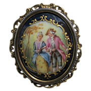 Antique Enamel brooch depicting a courting couple, set in gilded silver mounting