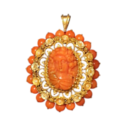 Eighteen karat yellow gold and tomato red Coral Cameo pendant, first half  19th century