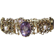 Fourteen karat yellow gold bracelet adorned with Amethysts and cultured pearls