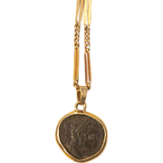 Ancient Roman coin pendant set in 14k yellow gold