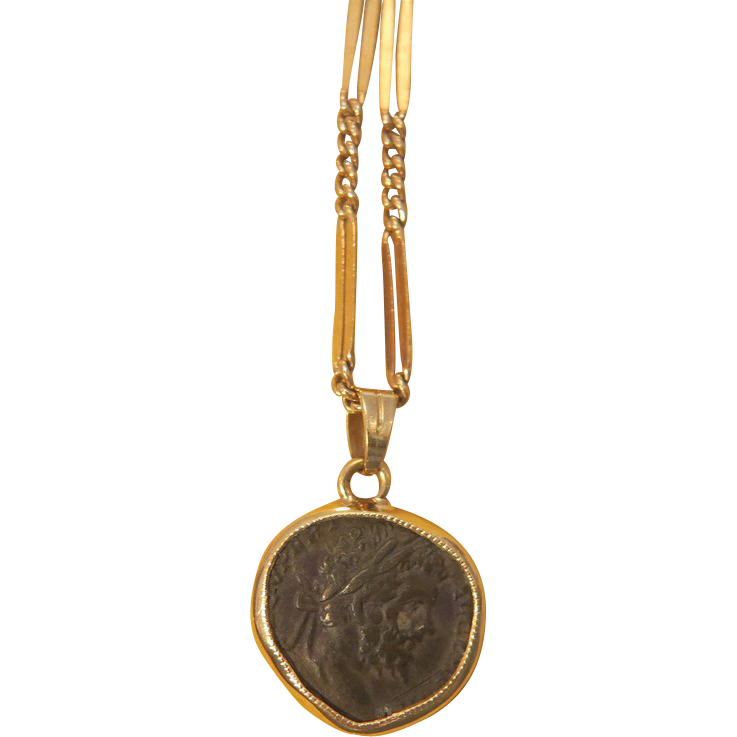 ancient coin pendant set in 14k yellow gold from