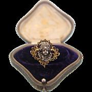 Victorian gilt silver brooch featuring an angel´s head, 19th century