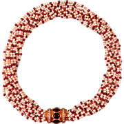 Natural seed pearl and Ruby necklace with a Diamond and Garnet cabochon closure, set 18 karat yellow gold