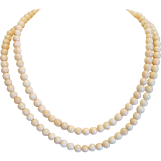 Vintage Coral necklace with a 14k yellow gold ring, ca. 1960