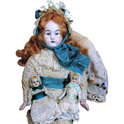 """Four Tiny 2 1/4"""" All Bisque Antique Miniature dollhouse baby dolls in a box of accessories,"""