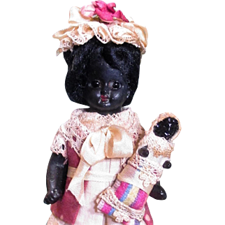 "Unusual African Beauty, 4"" Bisque (glass eyes) Antique Black Doll & dolly baby"