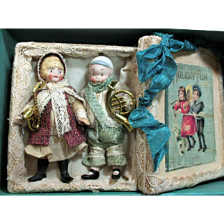 """Holiday fun"" Two Tiny 3 1/2"" Bisque Head Comic Dolls in keepsake box"