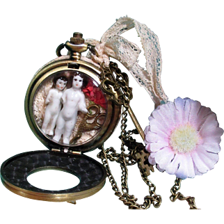 Lovely China/bisque tiny Frozen Charlotte dolls watch case Necklace