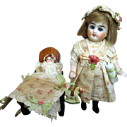 """Lovely 5"""" (glass eyes, swivel neck) All Bisque Antique Mignonette doll & mini 1 3/4"""" all Bisque Baby"""