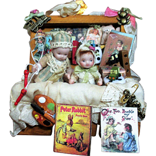 """Two Tiny miniature 2 1/2"""" All Bisque vintage baby Boy & girl dollhouse dolls in trunk of toys"""