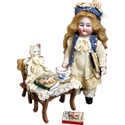 """ Story Time"" 5"" Lovely all bisque Antique German Mignonette Dollhouse doll & 2 1/2"" Dolly with accessories"