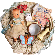 """Tiny 3 3/4"""" Miniature Antique Composition Dollhouse baby doll in basket of accessories"""