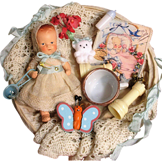 "Tiny 3 3/4"" Miniature Antique Composition Dollhouse baby doll in basket of accessories"