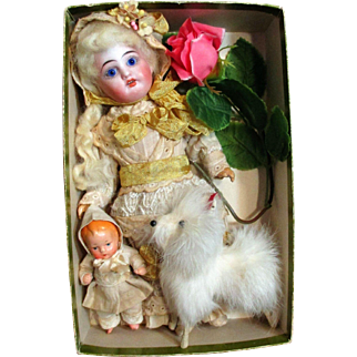 "Lovely 8 1/2"" Bisque head (glass eyes), composition body Antique Doll, 3 1/4"" Baby doll & furry puppy in Box"