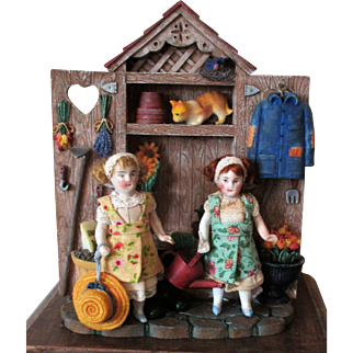 """"""" Tiny Gardeners"""" Two tiny 3"""" All Bisque Antique Dollhouse sisters in Garden Display setting"""