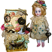 "Tiny little 3 1/2"" All Bisque Antique (glass eyes) Mignonette doll with trunk of keepsakes"