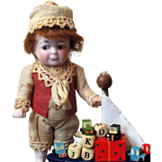 "Cutest 4 1/2"" (with Bare feet )All Bisque Antique Little Impish boy Doll & a Boat full of toys"