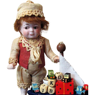 """Cutest 4 1/2"""" (with Bare feet )All Bisque Antique Little Impish boy Doll & a Boat full of toys"""