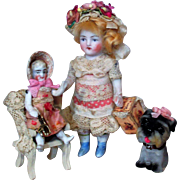 """"""" Pretty in Pink Sisters"""" Two lovely 4 1/4"""" All Bisque German Mignonette Dollhouse doll & 2 1/2"""" Sister Dolly with Puppy"""