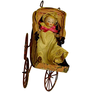 """Vintage Bisque Baby In Her Tin Painted """"Pink"""" Baby Buggy"""