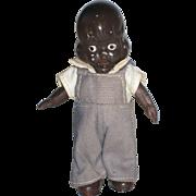 Small Black Americana Metal Doll
