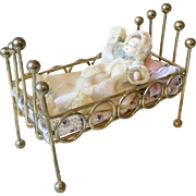 Dollhouse Brass Crib with Baby