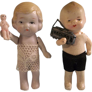 Adorable Pair of All Bisque Dolls with Toys