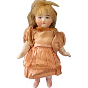 """All Bisque 4-1/2"""" Doll with Sweet Face and Beautiful Peach Dress"""