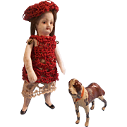 "Pretty  3-1/4"" All Bisque Girl in Crocheted Dress and Beret with her Pet Dog"