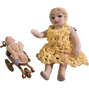 "Darling 2-3/16"" Little All Bisque Girl with her Teeny Tiny 3/4"" Frozen Baby Doll in Pram"