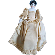 "Lovely 7.5"" Low Brow China Head Doll in Pretty Silky Gown"