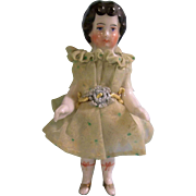 "Lovely 3-3/4"" Frozen Charlotte in Sweet Dress"